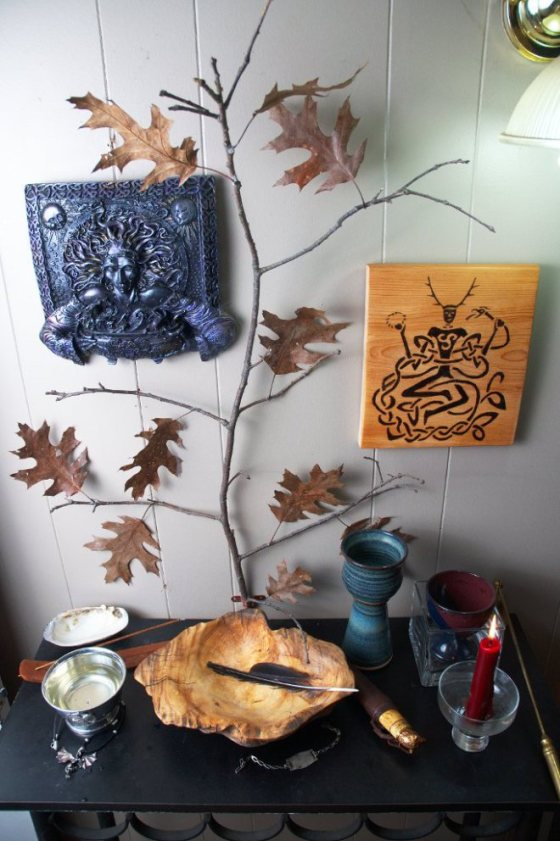 """This shrine is where I keep my hallows (fire, well, tree) as well as the icons of my patrons, Cerridwen and Cernunnos.  I also keep here a bracelet given to my grandfather from my grandmother as a token of my ancestors."""