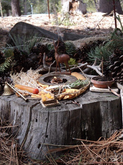Here's a natural outdoor alter, I love how they used the stump.